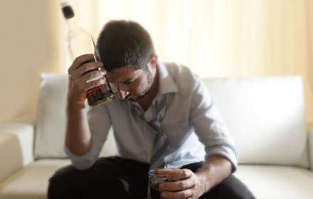 messy drunk businessman drinking alcohol at home