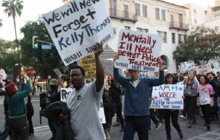Courtesy Photo: California residents march following the death of Kelly Thomas, a mentally ill many beaten by police in Fullereton in Orange County. He died from the wounds five days after being hospitalized.