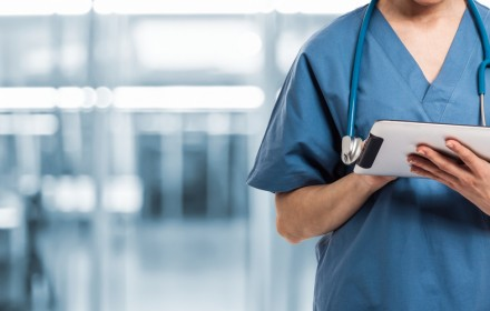 Healthcare And Medicine. Doctor using a digital tablet