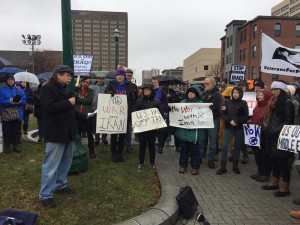 Protesters gathered downtown Syracuse Saturday to demonstrate against a  potential war with Iran
